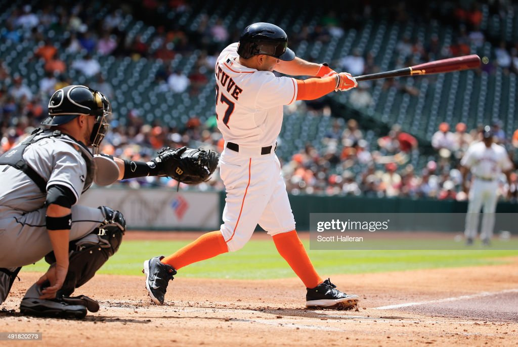 Jose Altuve #27 of the Houston Astros hits a single in the first inning of their game against the Chicago White Sox at Minute Maid Park on May 17, 2014 in Houston, Texas.