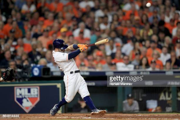Jose Altuve of the Houston Astros hits a solo home run against Tommy Kahnle of the New York Yankees during the fifth inning in Game Seven of the...