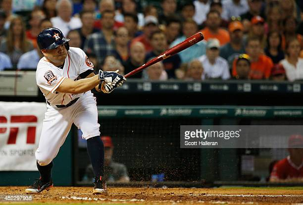 Jose Altuve of the Houston Astros hits an RBI single off Garrett Richards of the Los Angeles Angels of Anaheim in the fifth inning during their game...