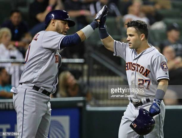 Jose Altuve of the Houston Astros is congratulated by Yuli Gurriel after hitting his 17th home run of the season a solo shot in the 7th inning...