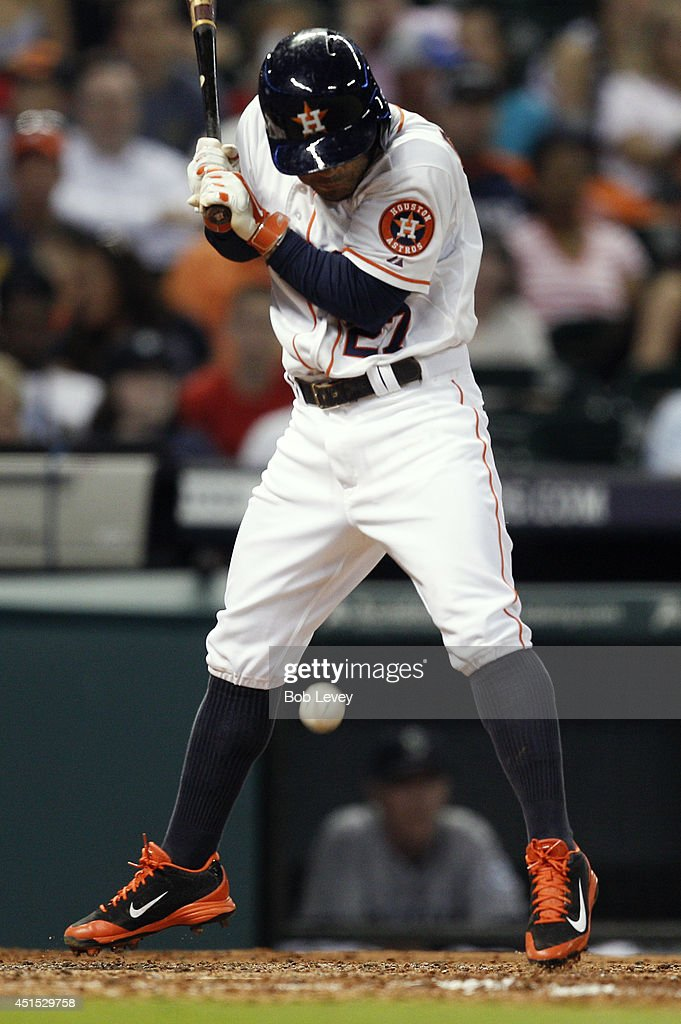 <a gi-track='captionPersonalityLinkClicked' href=/galleries/search?phrase=Jose+Altuve&family=editorial&specificpeople=7934195 ng-click='$event.stopPropagation()'>Jose Altuve</a> #27 of the Houston Astros is hit by a pitch in the fifth inning against the Seattle Mariners at Minute Maid Park on June 30, 2014 in Houston, Texas.