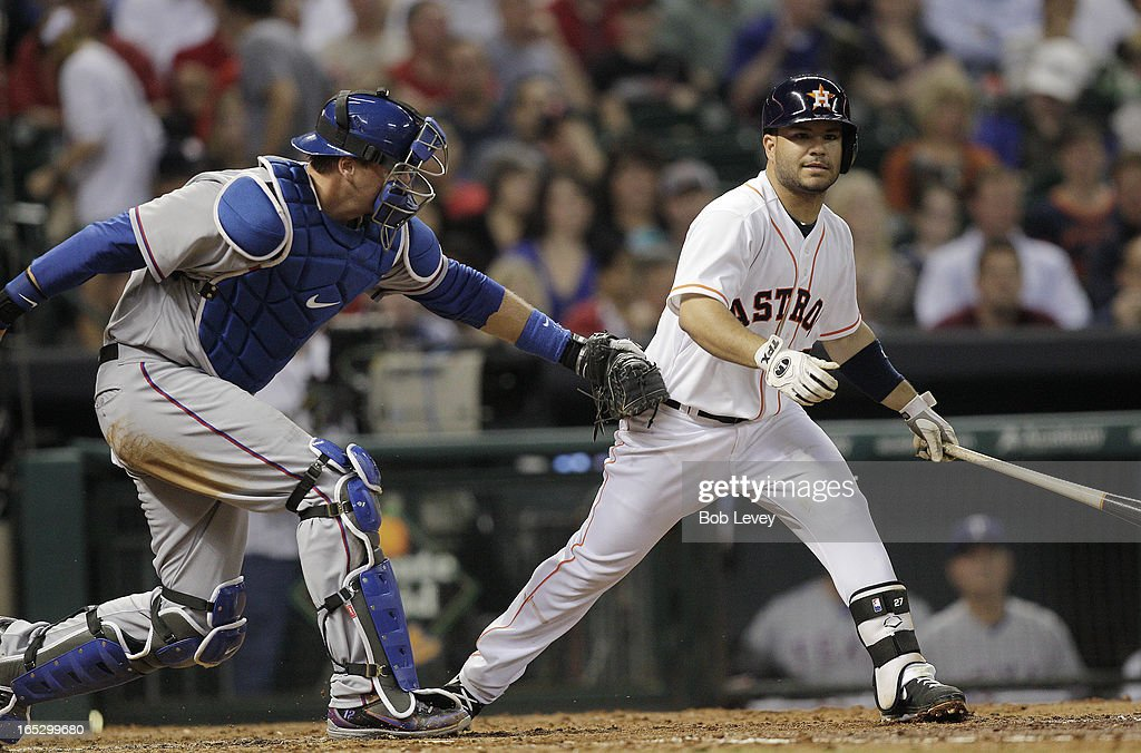 Jose Altuve #27 of the Houston Astros is tagged by <a gi-track='captionPersonalityLinkClicked' href=/galleries/search?phrase=A.J.+Pierzynski&family=editorial&specificpeople=204486 ng-click='$event.stopPropagation()'>A.J. Pierzynski</a> #12 of the Texas Rangers on a swinging strike three in the fourth inning at Minute Maid Park on April 2, 2013 in Houston, Texas.