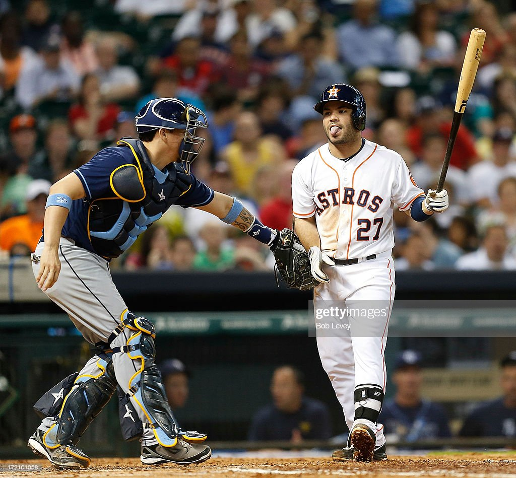 Jose Altuve #27 of the Houston Astros is tagged by catcher Jose Lobaton #59 of the Tampa Bay Rays on a strike three swing at Minute Maid Park on July 1, 2013 in Houston, Texas.