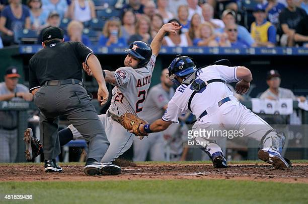 Jose Altuve of the Houston Astros is tagged out by Drew Butera of the Kansas City Royals as he tries to score in the fourth inning at Kauffman...