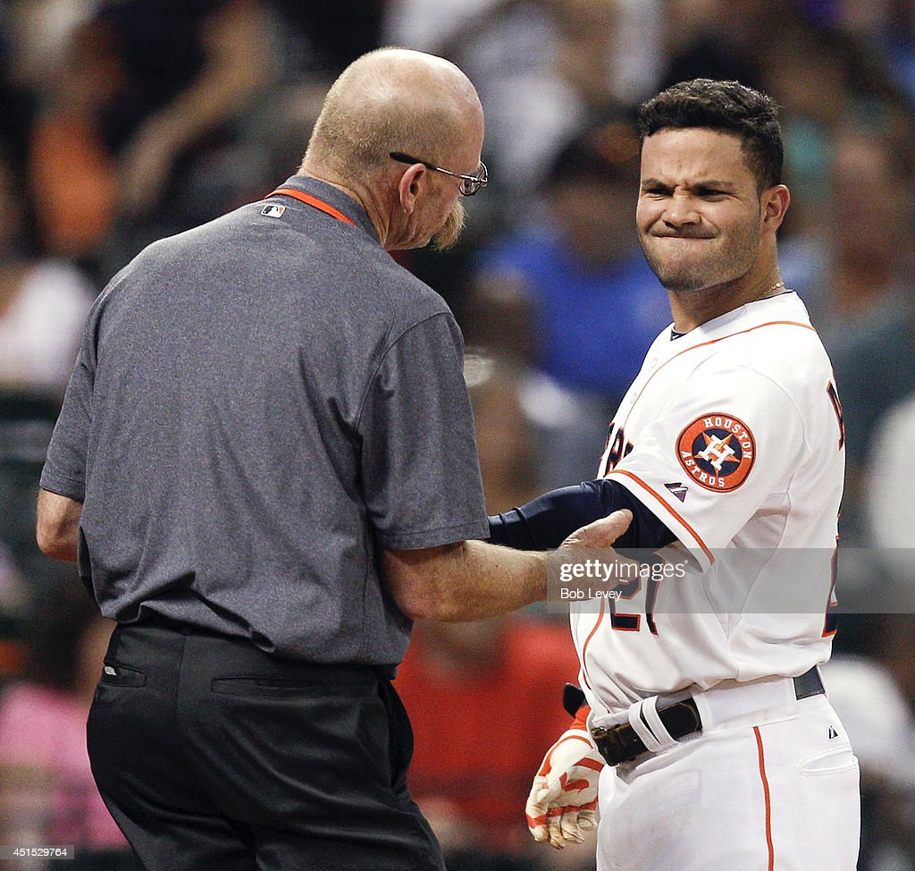 <a gi-track='captionPersonalityLinkClicked' href=/galleries/search?phrase=Jose+Altuve&family=editorial&specificpeople=7934195 ng-click='$event.stopPropagation()'>Jose Altuve</a> #27 of the Houston Astros is treated by assistant trainer Rex Jones after being hit by a pitch in the fifth inning against the Seattle Mariners at Minute Maid Park on June 30, 2014 in Houston, Texas.