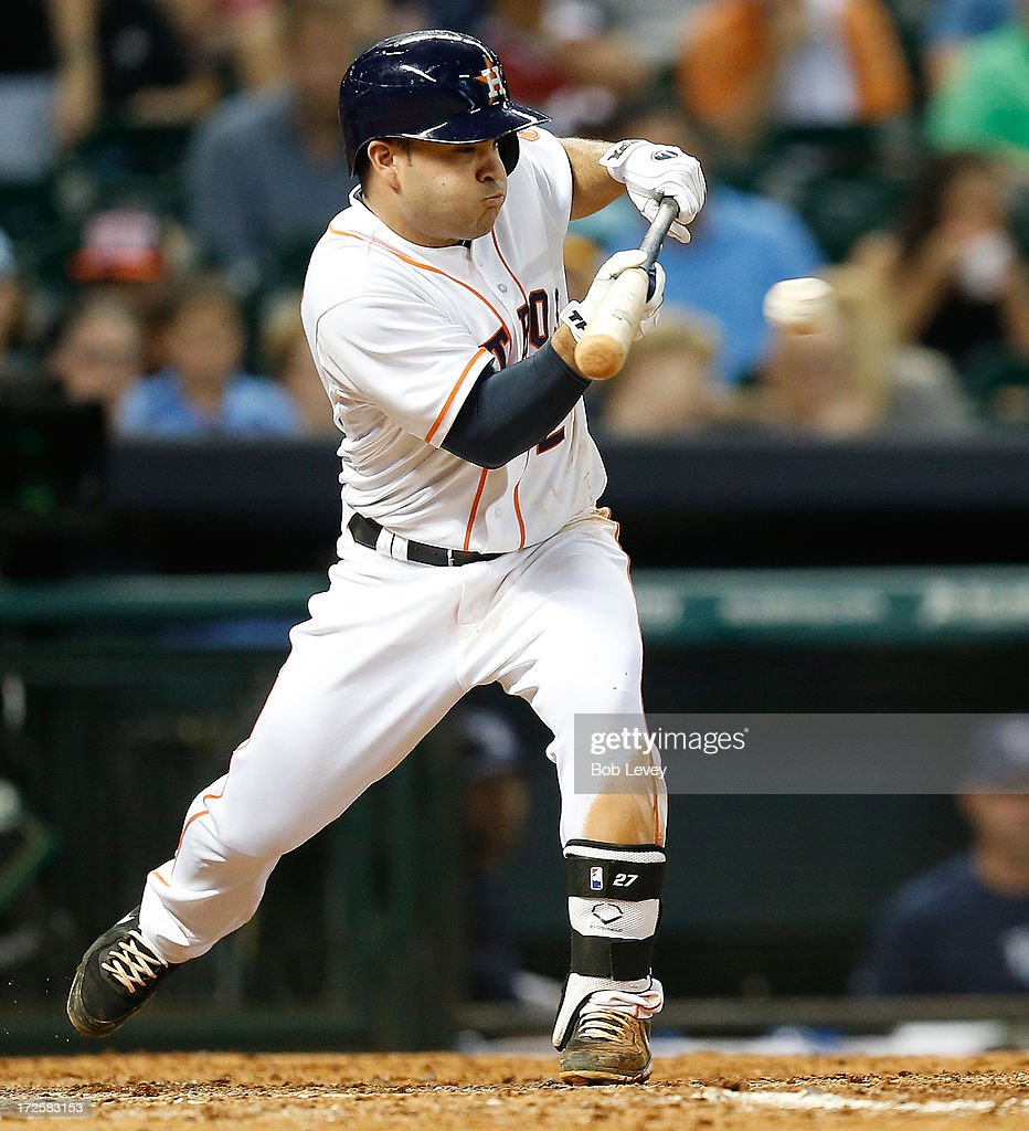 Jose Altuve #27 of the Houston Astros lays down a sacrifice bunt in the eighth inning Tampa Bay Rays at Minute Maid Park on July 3, 2013 in Houston, Texas.