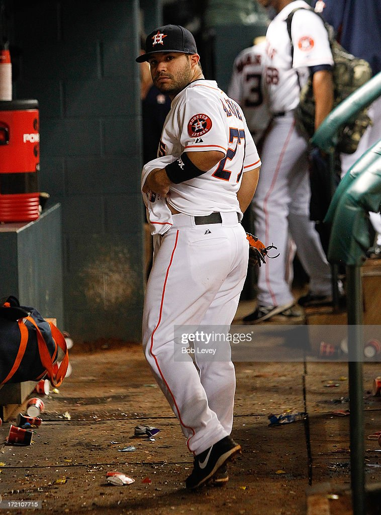 Jose Altuve #27 of the Houston Astros leaves an empty bench after the Houston Astros lost to the Tampa Bay Rays 12-0 at Minute Maid Park on July 1, 2013 in Houston, Texas.