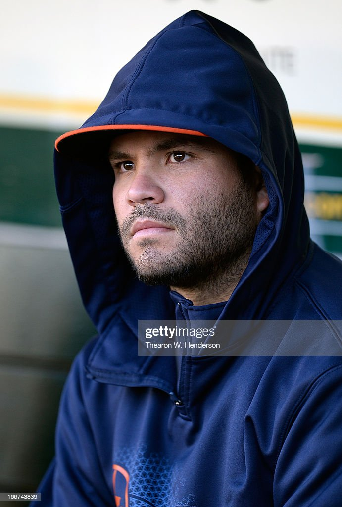 Jose Altuve of the Houston Astros looks on from the dugout before the start of his MLB baseball game against the Oakland Athletics at O.co Coliseum on April 15, 2013 in Oakland, California. All uniformed team members are wearing jersey number 42 in honor of Jackie Robinson Day.