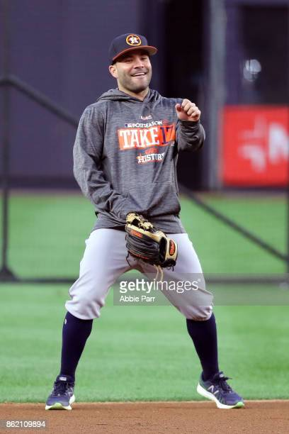 Jose Altuve of the Houston Astros looks on in the infield during batting practice before Game Three of the American League Championship Series...