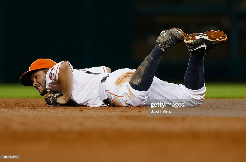 Jose Altuve #27 of the Houston Astros makes a diving play at second base in the sixth inning against the New York Yankees at Minute Maid Park on September 28, 2013 in Houston, Texas.