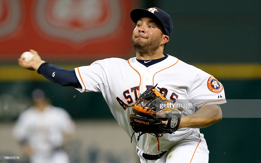 <a gi-track='captionPersonalityLinkClicked' href=/galleries/search?phrase=Jose+Altuve&family=editorial&specificpeople=7934195 ng-click='$event.stopPropagation()'>Jose Altuve</a> #27 of the Houston Astros makes a play at second base against the Los Angeles Angels of Anaheim during the third inning against the Houston Astros at Minute Maid Park on May 9, 2013 in Houston, Texas.