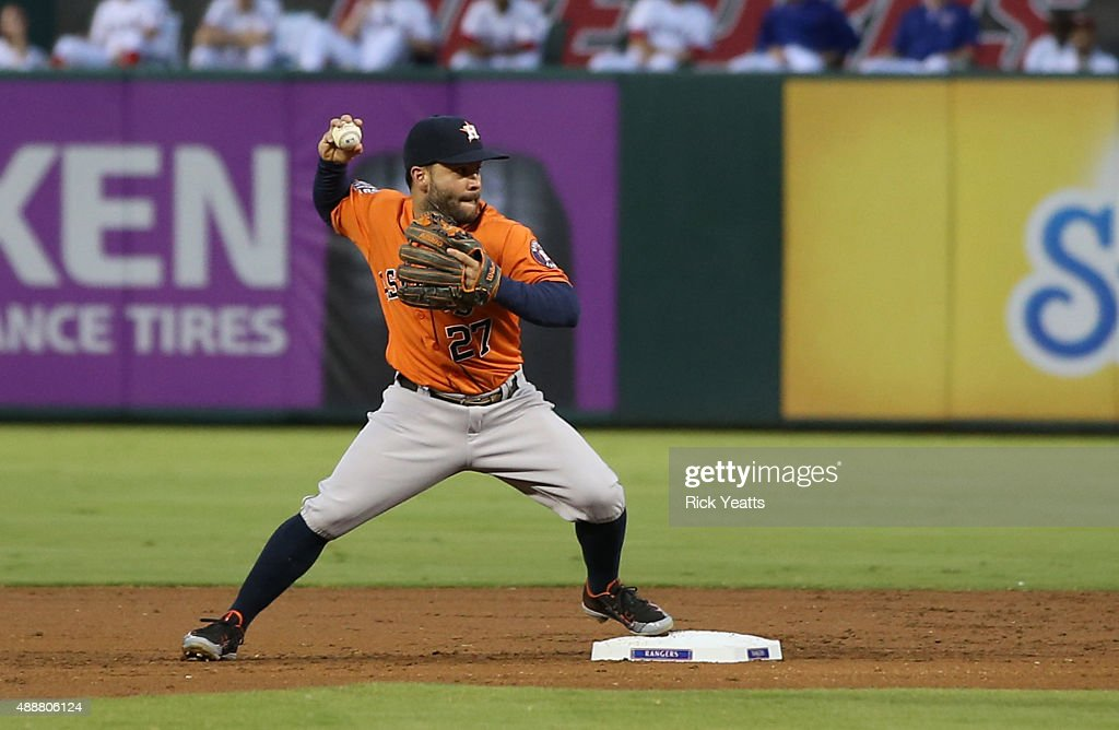 Jose Altuve of the Houston Astros makes the out in the first inning onPrince Fielder of the Texas Rangers at Global Life Park in Arlington on...