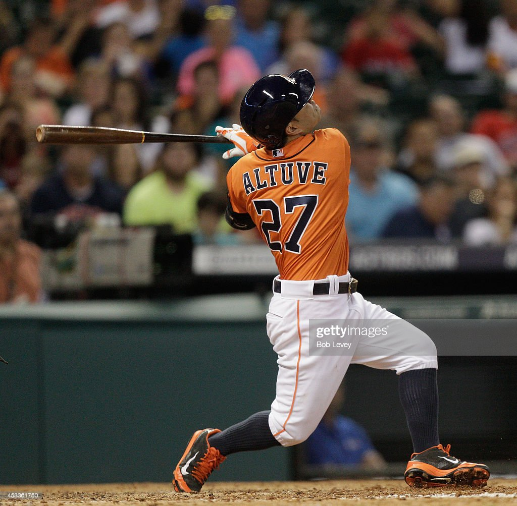 Jose Altuve #27 of the Houston Astros pops out in the fifth inning against the Texas Rangers at Minute Maid Park on August 8, 2014 in Houston, Texas. Altuve did not start the sixth inning due to stiffness in his neck.
