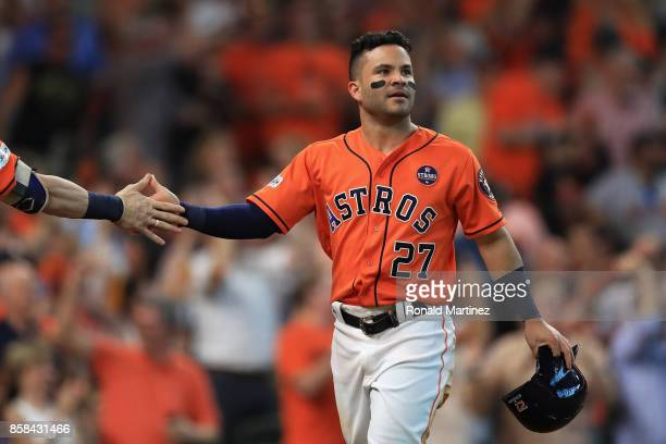 Jose Altuve of the Houston Astros reacts after scoring a run in the sixth inning against the Boston Red Sox during game two of the American League...