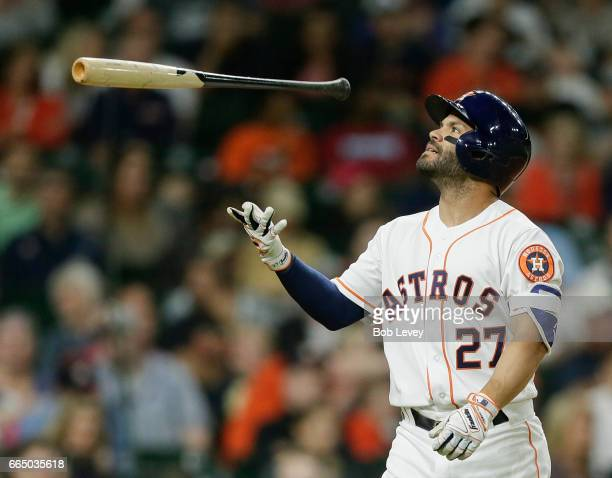 Jose Altuve of the Houston Astros reacts after striking out in the third inning against the Seattle Mariners at Minute Maid Park on April 5 2017 in...