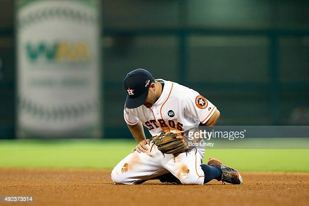Jose Altuve of the Houston Astros reacts after throwing to first for an out as the goahead run for the Kansas City Royals scores in the eighth inning...