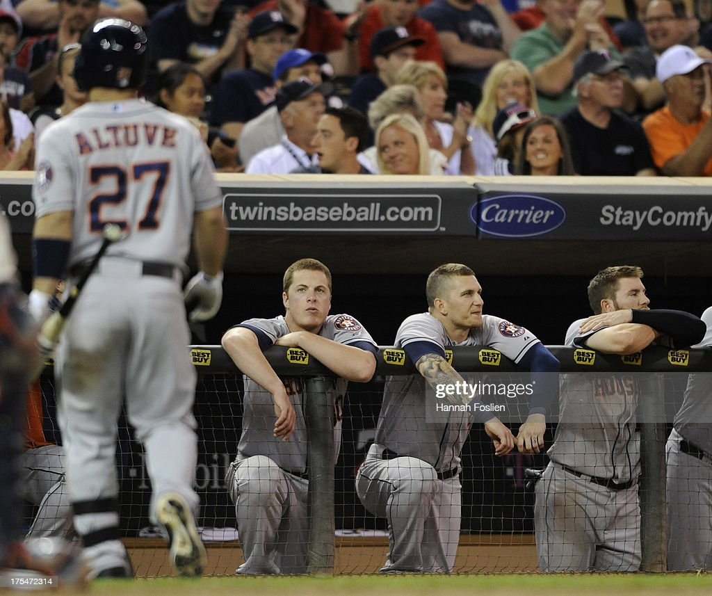 Jose Altuve #27 of the Houston Astros returns to the dugout after striking out as teammates Matt Dominguez #30, Brandon Barnes #2 and Robbie Grossman #19 look on during the ninth inning of the game against the Minnesota Twins on August 3, 2013 at Target Field in Minneapolis, Minnesota. The Twins defeated the Astros 6-4.
