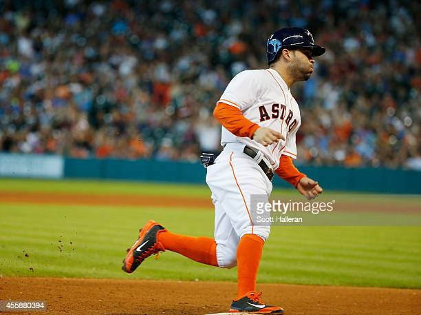 Jose Altuve of the Houston Astros rounds third base on the way to scoring a run during the fifth inning of their game against the Seattle Mariners at...