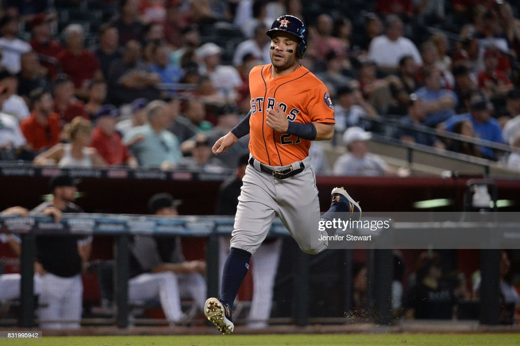 Jose Altuve #27 of the Houston Astros runs home to score in the fourth inning against the Arizona Diamondbacks at Chase Field on August 15, 2017 in Phoenix, Arizona.