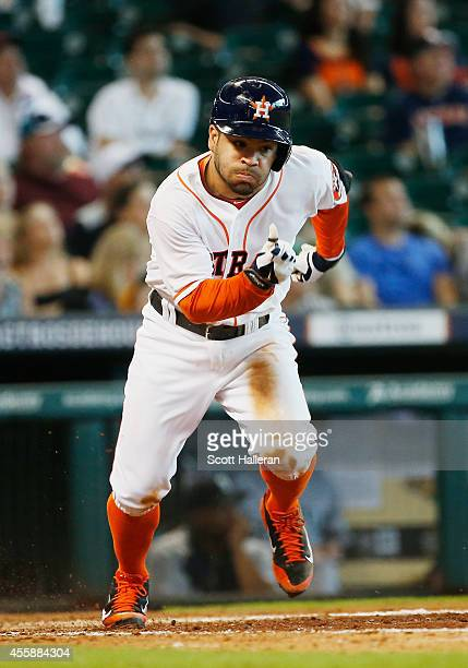 Jose Altuve of the Houston Astros runs to first base after an infield single during the eighth inning of their game against the Seattle Mariners at...
