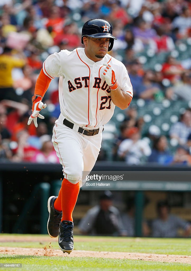 <a gi-track='captionPersonalityLinkClicked' href=/galleries/search?phrase=Jose+Altuve&family=editorial&specificpeople=7934195 ng-click='$event.stopPropagation()'>Jose Altuve</a> #27 of the Houston Astros runs to first base during their game against the Chicago White Sox at Minute Maid Park on May 17, 2014 in Houston, Texas.