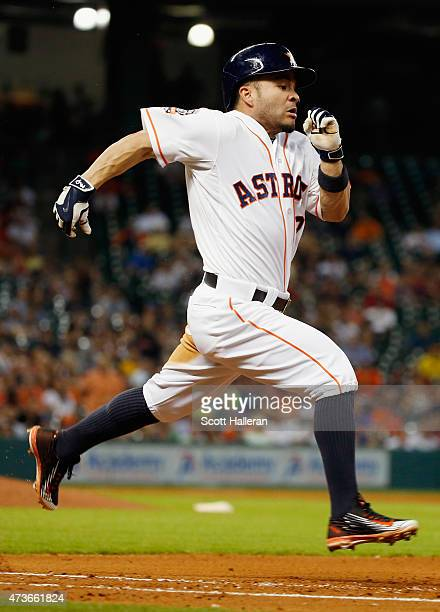 Jose Altuve of the Houston Astros runs to first base in the fourth inning of their game against the Toronto Blue Jays at Minute Maid Park on May 16...