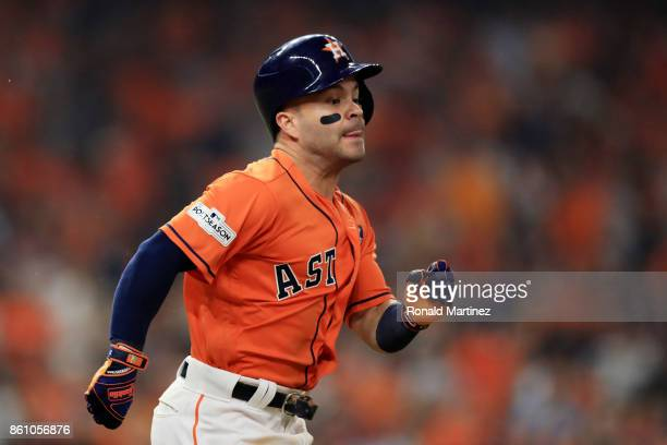 Jose Altuve of the Houston Astros runs to first on a single in the fourth inning against the New York Yankees during game one of the American League...