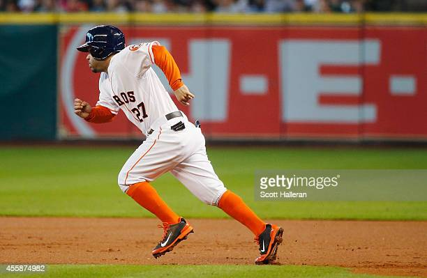 Jose Altuve of the Houston Astros runs to second base during the first inning of their game against the Seattle Mariners at Minute Maid Park on...