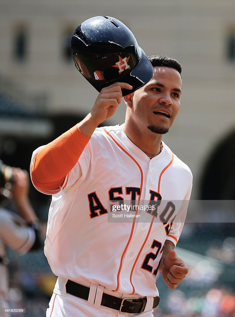 Jose Altuve #27 of the Houston Astros scores a run in the first inning of their game against the Chicago White Sox at Minute Maid Park on May 17, 2014 in Houston, Texas.