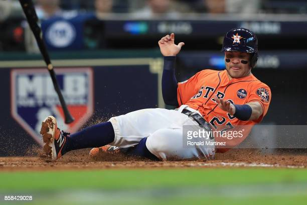 Jose Altuve of the Houston Astros scores a run in the sixth inning against the Boston Red Sox during game two of the American League Division Series...