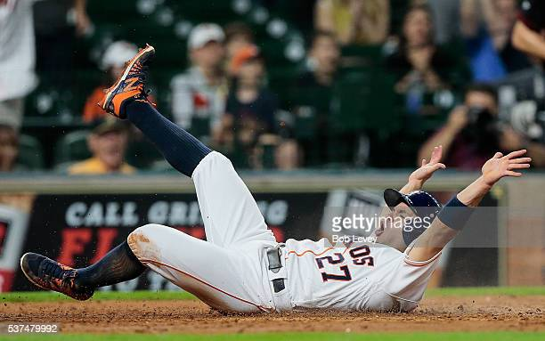 Jose Altuve of the Houston Astros scores in the fifth inning on a single by Carlos Correa against the Arizona Diamondbacks at Minute Maid Park on...