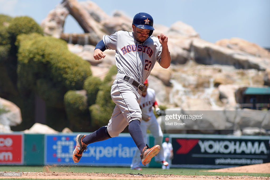 <a gi-track='captionPersonalityLinkClicked' href=/galleries/search?phrase=Jose+Altuve&family=editorial&specificpeople=7934195 ng-click='$event.stopPropagation()'>Jose Altuve</a> #27 of the Houston Astros scores on a a sacrifice fly by Luis Valbuena during the third inning of the game against the Los Angeles Angels of Anaheim at Angel Stadium of Anaheim on June 29, 2016 in Anaheim, California.