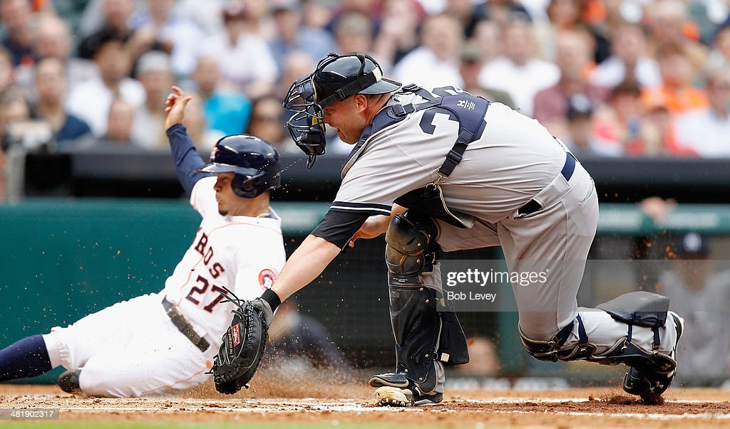 <a gi-track='captionPersonalityLinkClicked' href=/galleries/search?phrase=Jose+Altuve&family=editorial&specificpeople=7934195 ng-click='$event.stopPropagation()'>Jose Altuve</a> #27 of the Houston Astros scores on a wild pitch by CC Sabathia #52 of the New York Yankees (not pictured) in the second inning as catcher <a gi-track='captionPersonalityLinkClicked' href=/galleries/search?phrase=Brian+McCann+-+Baseball+Player&family=editorial&specificpeople=593065 ng-click='$event.stopPropagation()'>Brian McCann</a> #34 can't handle the throw at Minute Maid Park on April 1, 2014 in Houston, Texas.