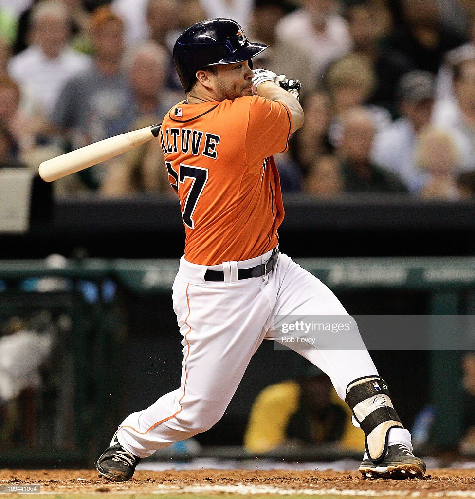 <a gi-track='captionPersonalityLinkClicked' href=/galleries/search?phrase=Jose+Altuve&family=editorial&specificpeople=7934195 ng-click='$event.stopPropagation()'>Jose Altuve</a> #27 of the Houston Astros singles in Ronny Cedeno #13 of the Houston Astros in the fifth inning against the Oakland Athletics at Minute Maid Park on May 24, 2013 in Houston, Texas.