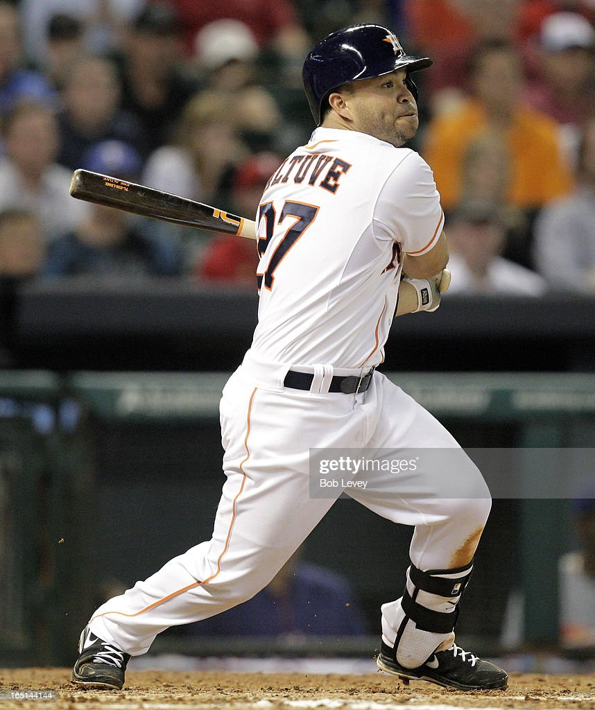 <a gi-track='captionPersonalityLinkClicked' href=/galleries/search?phrase=Jose+Altuve&family=editorial&specificpeople=7934195 ng-click='$event.stopPropagation()'>Jose Altuve</a> #27 of the Houston Astros singles in the fifth inning scoring Ronny Cedeno #13 of the Houston Astros against the Texas Rangers on Opening Day at Minute Maid Park on March 31, 2013 in Houston, Texas.