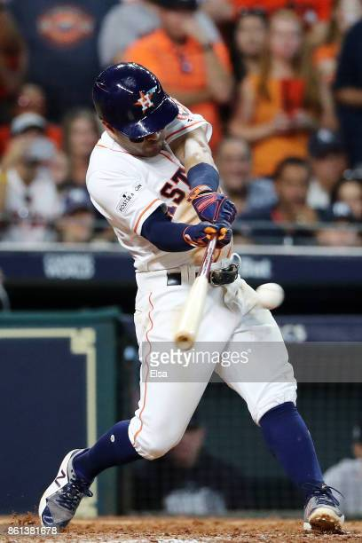 Jose Altuve of the Houston Astros singles in the ninth inning against the New York Yankees during game two of the American League Championship Series...
