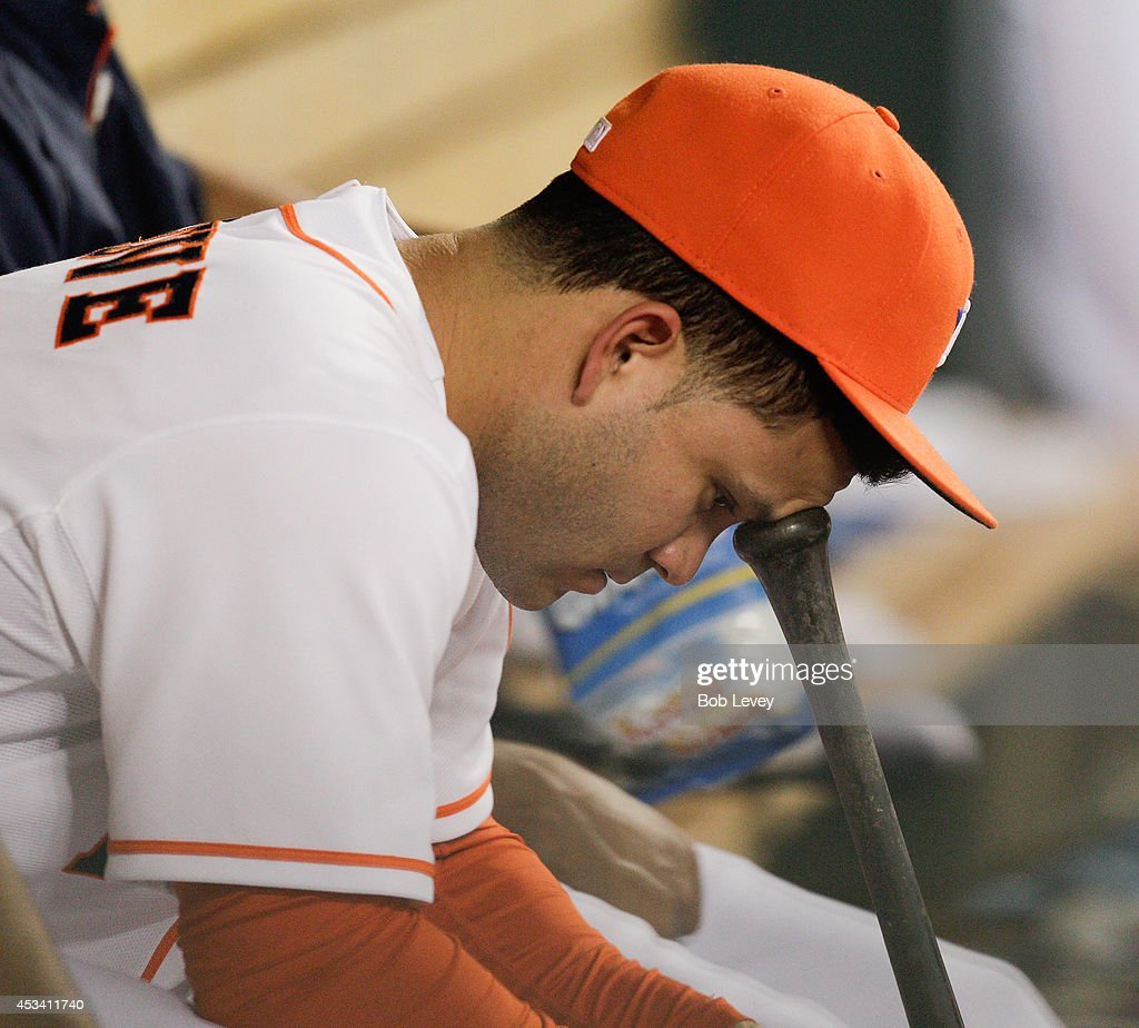 Jose Altuve #27 of the Houston Astros sits on the bench during a game against the Texas Rangers at Minute Maid Park on August 9, 2014 in Houston, Texas. Altuve was out of the lineup due to a sore neck.