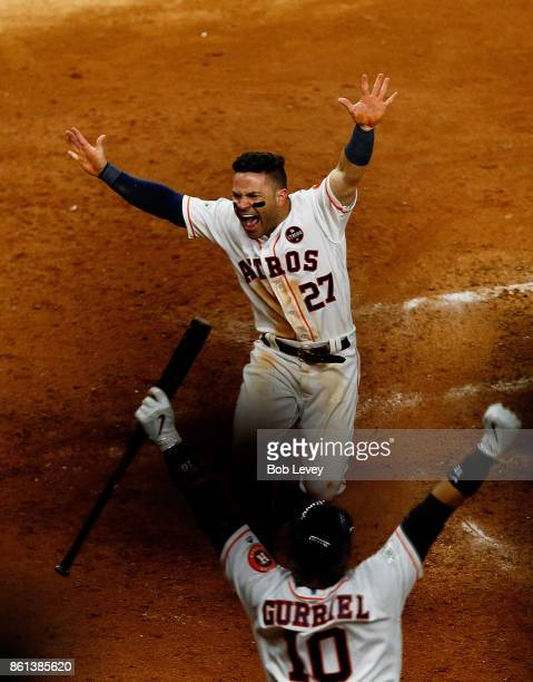 Jose Altuve of the Houston Astros slides home to score the winning run against the New York Yankees in the ninth inning during game two of the...