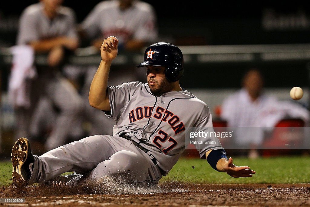 <a gi-track='captionPersonalityLinkClicked' href=/galleries/search?phrase=Jose+Altuve&family=editorial&specificpeople=7934195 ng-click='$event.stopPropagation()'>Jose Altuve</a> #27 of the Houston Astros slides into home plate to score off of a Brett Wallace #29 (not pictured) single in the sixth inning against the Baltimore Orioles at Oriole Park at Camden Yards on July 31, 2013 in Baltimore, Maryland.
