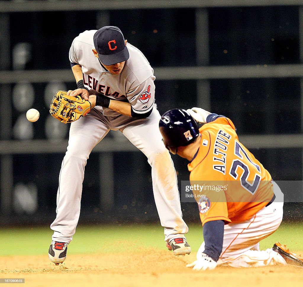 <a gi-track='captionPersonalityLinkClicked' href=/galleries/search?phrase=Jose+Altuve&family=editorial&specificpeople=7934195 ng-click='$event.stopPropagation()'>Jose Altuve</a> #27 of the Houston Astros slides into second base as <a gi-track='captionPersonalityLinkClicked' href=/galleries/search?phrase=Asdrubal+Cabrera&family=editorial&specificpeople=834042 ng-click='$event.stopPropagation()'>Asdrubal Cabrera</a> #13 of the Cleveland Indians can't handle the throw at Minute Maid Park on April 19, 2013 in Houston, Texas.