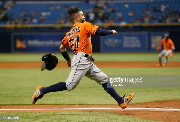 Jose Altuve of the Houston Astros sprints home to score off of an RBI single by Yuli Gurriel during the 10th inning of a game against the Tampa Bay...