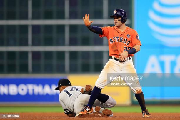Jose Altuve of the Houston Astros steals second against Starlin Castro of the New York Yankees in the fourth inning during game one of the American...