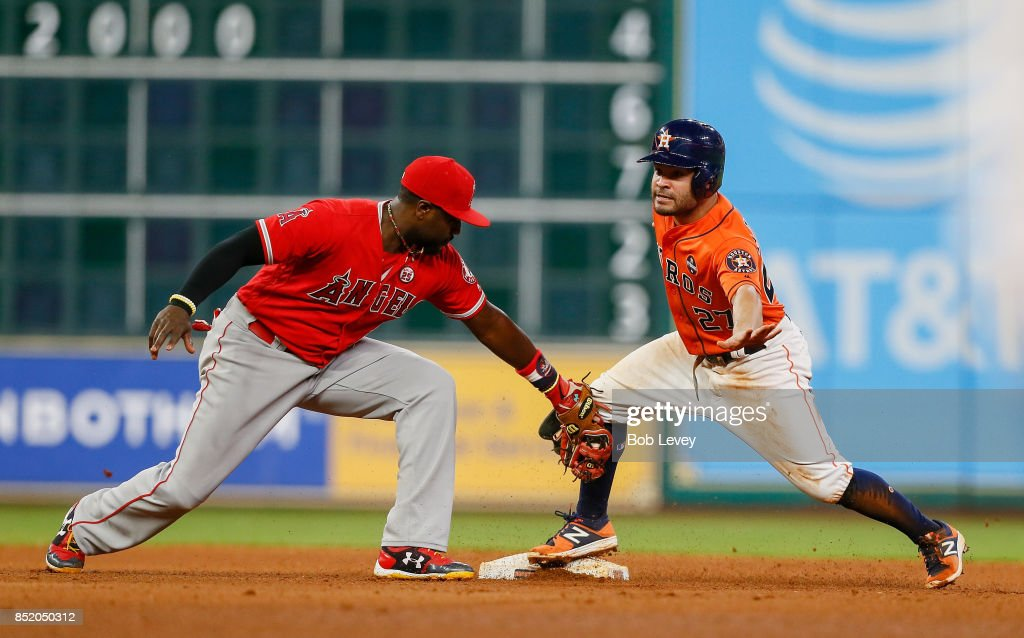 Jose Altuve #27 of the Houston Astros steals second base as in the seventh inning as Brandon Phillips #4 of the Los Angeles Angels of Anaheim is late with the tag at Minute Maid Park on September 22, 2017 in Houston, Texas.