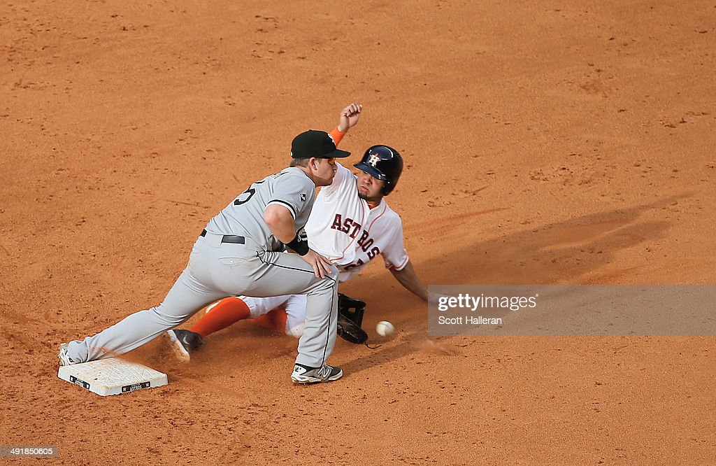 <a gi-track='captionPersonalityLinkClicked' href=/galleries/search?phrase=Jose+Altuve&family=editorial&specificpeople=7934195 ng-click='$event.stopPropagation()'>Jose Altuve</a> #27 of the Houston Astros steals second base in the eighth inning of their game under the tag of <a gi-track='captionPersonalityLinkClicked' href=/galleries/search?phrase=Gordon+Beckham&family=editorial&specificpeople=5411079 ng-click='$event.stopPropagation()'>Gordon Beckham</a> #15 of the Chicago White Sox at Minute Maid Park on May 17, 2014 in Houston, Texas.
