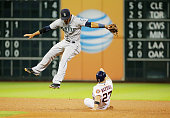Jose Altuve of the Houston Astros steals second base in the sixth inning ounder Ketel Marte of the Seattle Mariners during their game at Minute Maid...