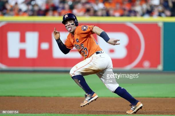 Jose Altuve of the Houston Astros steals second on a wild pitch in the sixth inning against the New York Yankees during game one of the American...