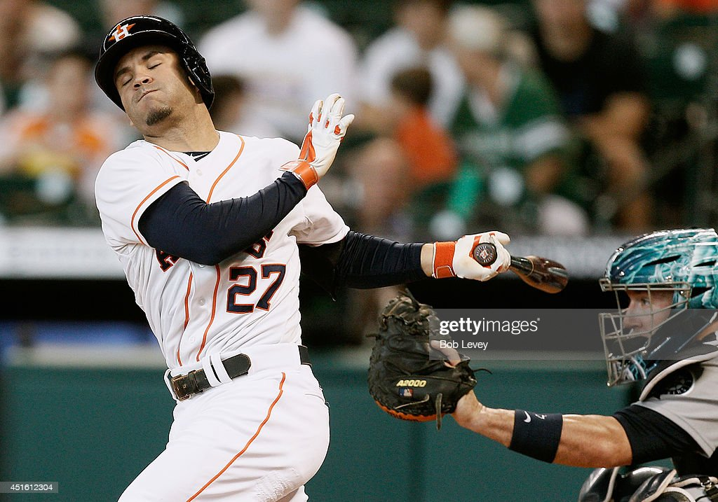 <a gi-track='captionPersonalityLinkClicked' href=/galleries/search?phrase=Jose+Altuve&family=editorial&specificpeople=7934195 ng-click='$event.stopPropagation()'>Jose Altuve</a> #27 of the Houston Astros strikes out in the first inning as catcher <a gi-track='captionPersonalityLinkClicked' href=/galleries/search?phrase=John+Buck&family=editorial&specificpeople=213730 ng-click='$event.stopPropagation()'>John Buck</a> #4 of the Seattle Mariners catches the ball at Minute Maid Park on July 2, 2014 in Houston, Texas.