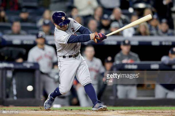 Jose Altuve of the Houston Astros strikes out swinging against the New York Yankees during the first inning in Game Three of the American League...