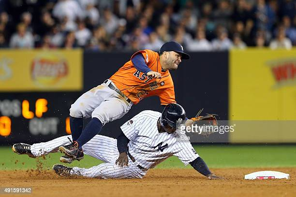 Jose Altuve of the Houston Astros tags out Didi Gregorius of the New York Yankees in the sixth inning during the American League Wild Card Game at...