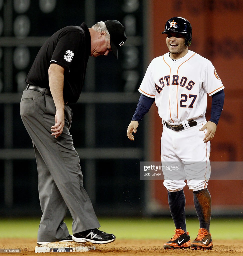 <a gi-track='captionPersonalityLinkClicked' href=/galleries/search?phrase=Jose+Altuve&family=editorial&specificpeople=7934195 ng-click='$event.stopPropagation()'>Jose Altuve</a> #27 of the Houston Astros takes a moment after stealing second base as umpire <a gi-track='captionPersonalityLinkClicked' href=/galleries/search?phrase=Tim+Welke&family=editorial&specificpeople=224714 ng-click='$event.stopPropagation()'>Tim Welke</a> #3 checks the base against the Seattle Mariners at Minute Maid Park on June 30, 2014 in Houston, Texas.